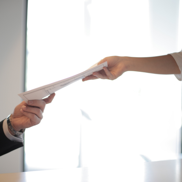 person handing over employment contract to employer