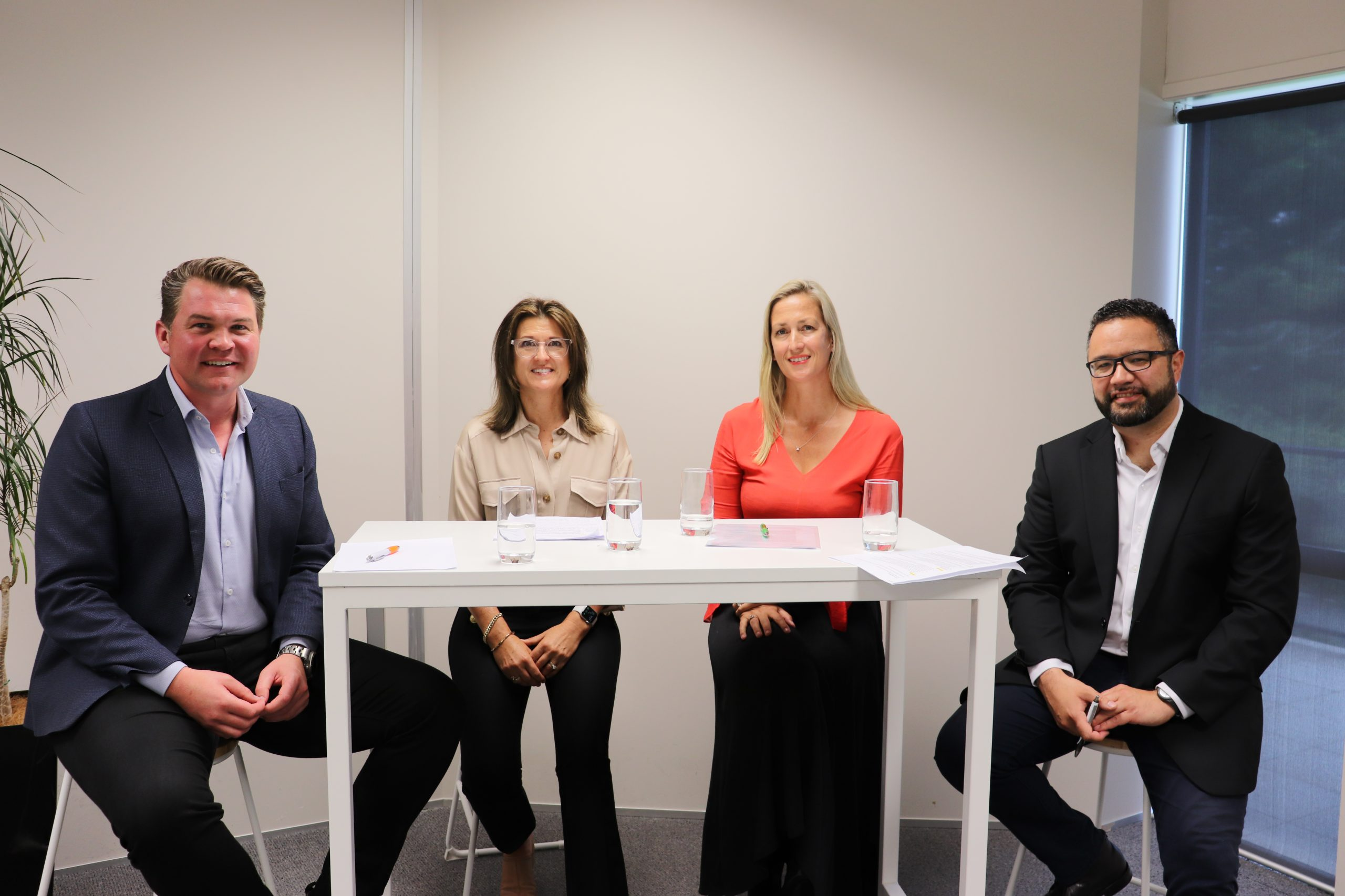 Business leaders sit on a panel discussion with CEO Matt Cowley