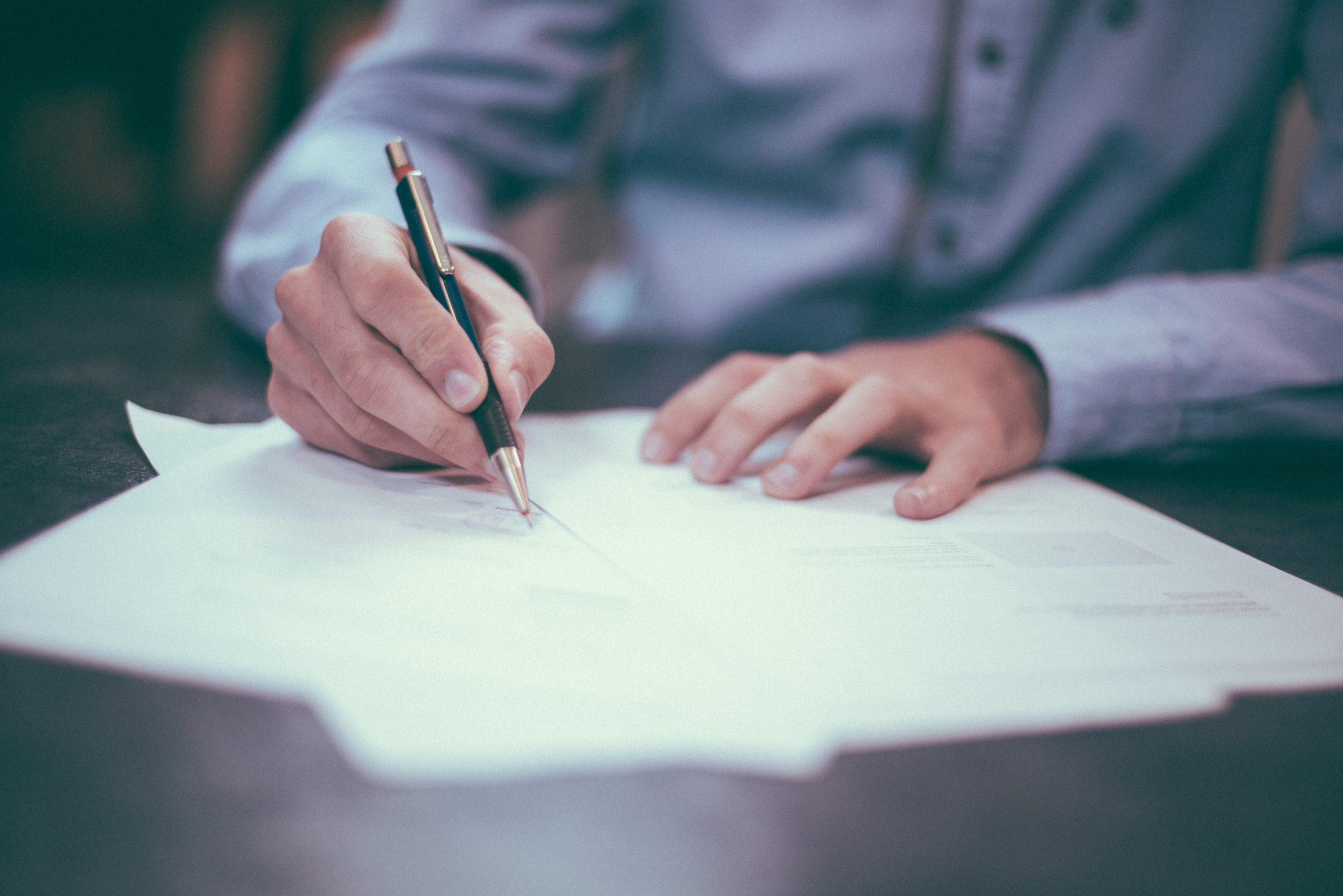 Wills Month - someone signing a will