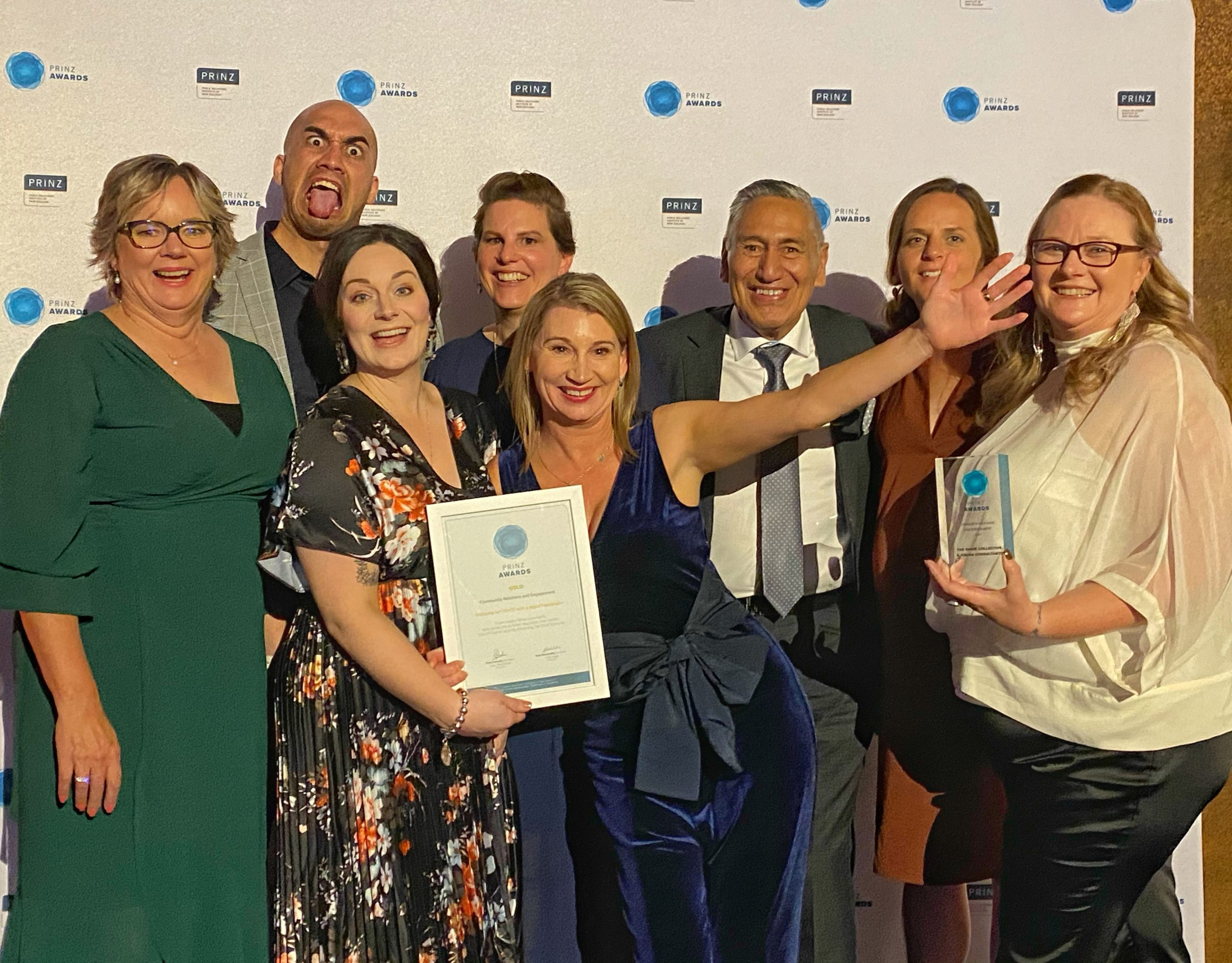 The team from Shine Collective with their award at the PRINZ Awards.