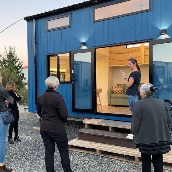 Tiny House Builders owner Rebecca Bartlett stands in front of a tiny house