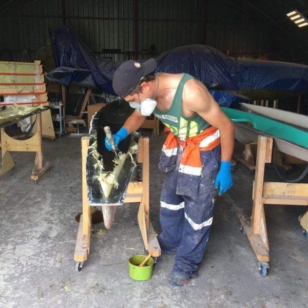 Tim Taylor working on a kayak