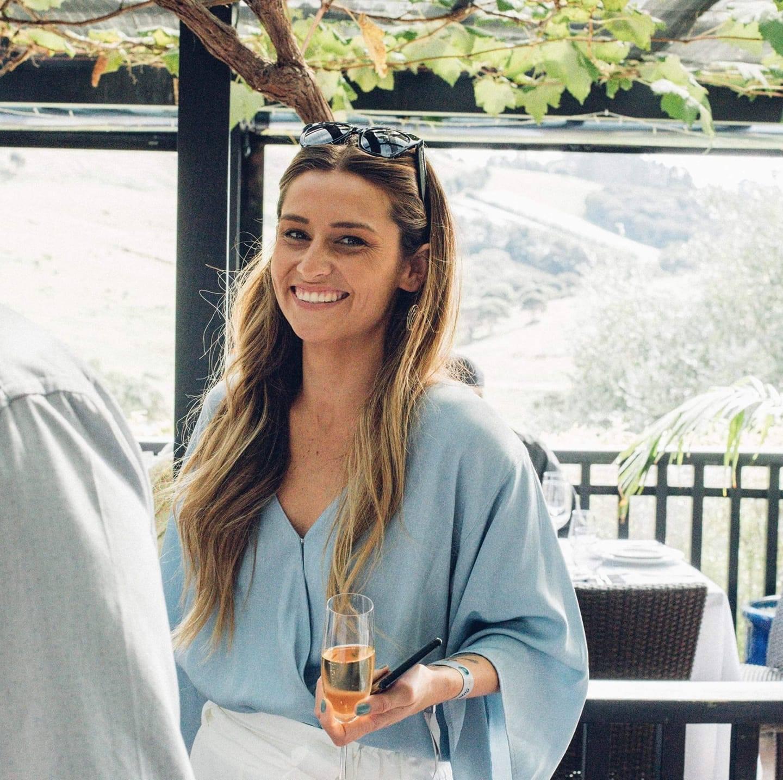 Alisha King holding a wine glass